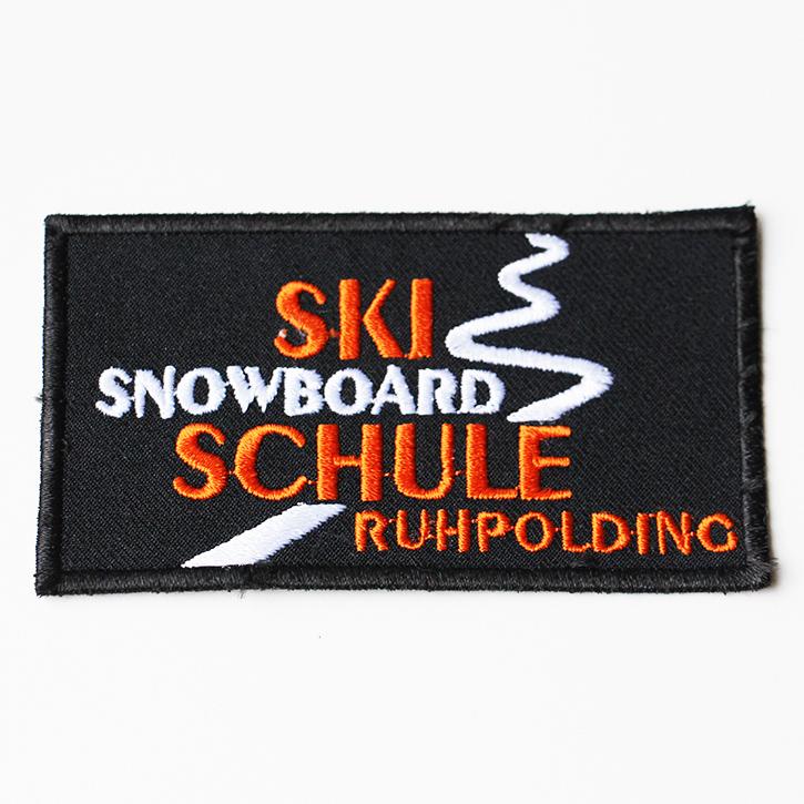 gesticktes Logo Skischule und Snowboard